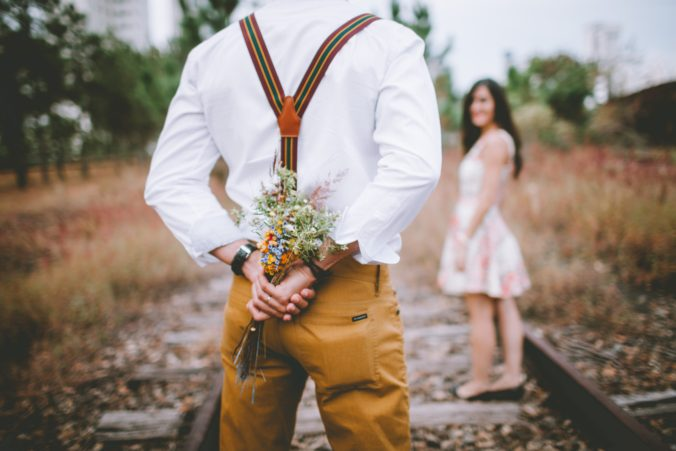 courtship with man bringing flowers to his prospect